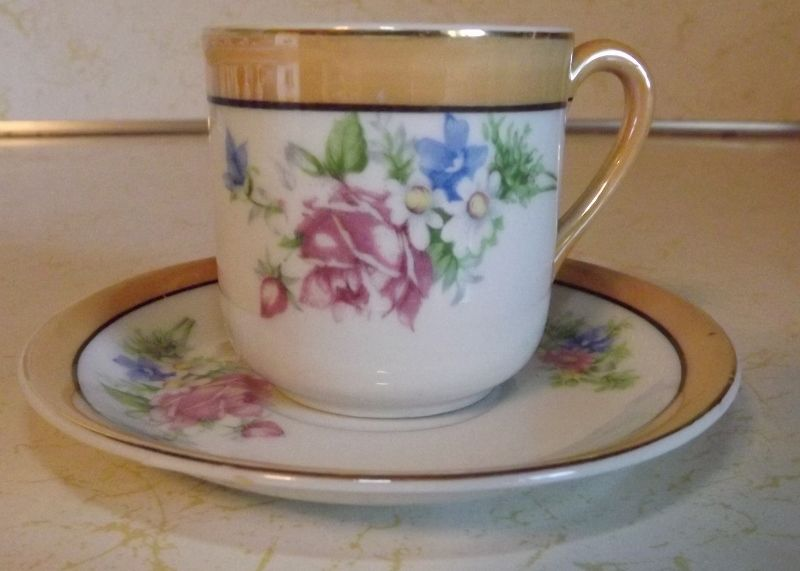 Coffee cup and saucer demitasse Made in Occupied Japan with flower motif
