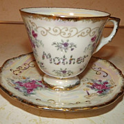 REDUCED Iridescent Mother teacup and saucer with Enesco Imports foil Japan label