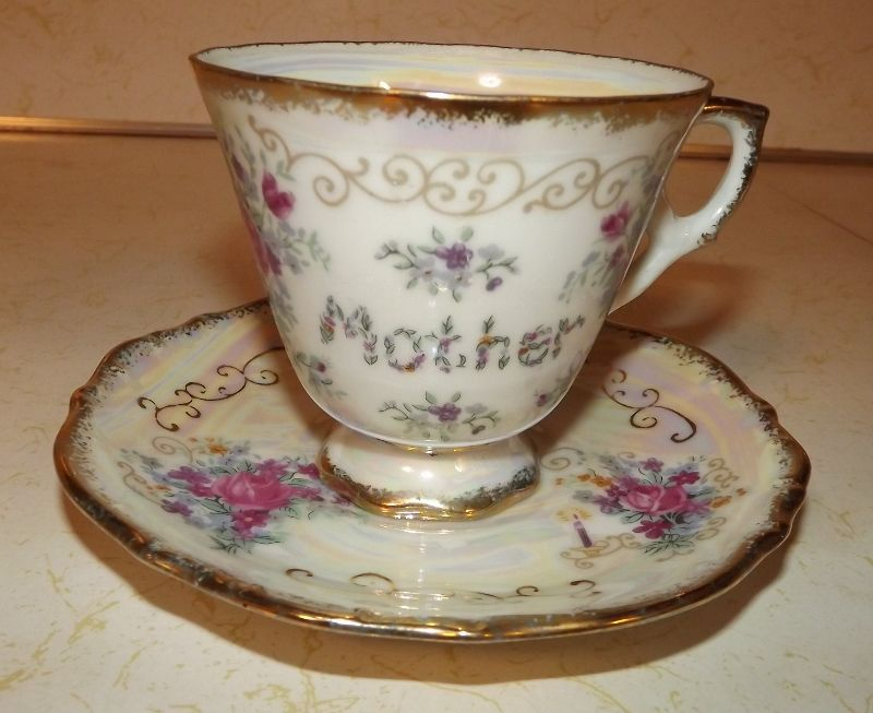 Iridescent Mother teacup and saucer with Enesco Imports foil Japan label