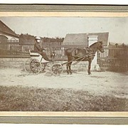 Lady in a Horse-drawn Carriage. Vintage Photo.