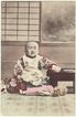 Japanese Baby with Doll. Old, Tinted Postcard