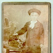 Old Cabinet Photo of a Boy with an Oldtimer Car