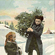1902: Lovely Xmas postcard Boy and Girl with Christmas Tree