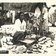 1932: Malang (Netherlands Indies) Real Photo depicting a lady at the market.