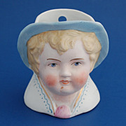 Bisque vase planter of child's doll face unmarked  3 1/2""
