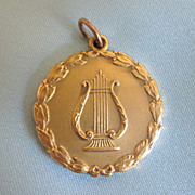 Wonderful 1927 Pendant Gold Filled Large Pendant or Charm With Lyre and Garland