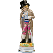 Hand Painted Figurine of Young Boy In Coat