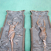 SOLD Two Bronze Plaques one holding torch one a flag