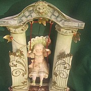 Swinging Doll in Garden Gate Marked Germany 10393
