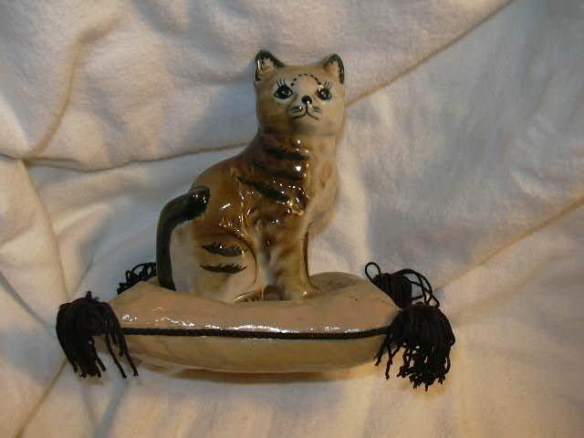 Old Ceramic Cat on a fringed Paper Mache Pillow Fine Statue or Figurine