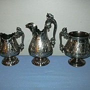 James W Tufts Silver Quadruple Plate 3Pc Creamer Syrup Set With Face Mythological & Winged Ser