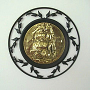 Black Metal Ivy Frame Features Brass Sailing Ship
