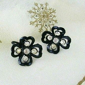 Molded Black Plastic Flowers With Rhinestone Centers