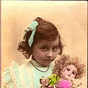 REDUCED Vintage Post Card Real Photo Tinted Girl in Blue with Bisque Head Doll