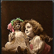 Vintage Post Card RPPC Tinted Girl with Bisque Head Doll
