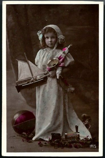 Vintage Post Card RPPC Tinted Girl with Bisque Head Doll and Toys