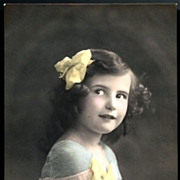 Vintage Post Card RPPC Tinted Girl in Blue with Yellow Bows