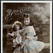 Vintage Post Card RPPC Tinted Edwardian Girl with Bisque Head Doll