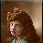 Vintage Post Card RPPC Tinted Girl with Wavy Hair and Pink Ribbon Bow