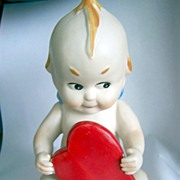 Large Japan Bisque Kewpie Holding a Red Heart