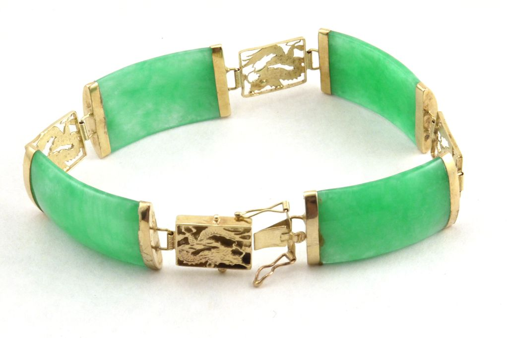 Jade bracelet with intricate dragon motif from for Pictures of jade jewelry