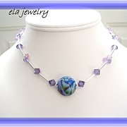 Lampwork Bead with Sterling Silver Tubes and Swarovski Crystals in Purples Necklace