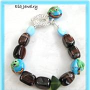 Delighted Surprise ~ Red Tiger Eye Nuggets with Lampwork Tadpole Bead Bracelet