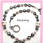 Dark Silver Disk Pendant with Pink Artisan Lampwork and Glass Pearl and Hematite Bead Necklace