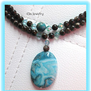Two Strand Blue Crazy Lace Agate Pendant with Dark Brown Glass Necklace