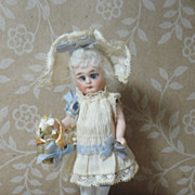 SALE Precious Tiny Antique All Bisque Doll With Two Dresses!