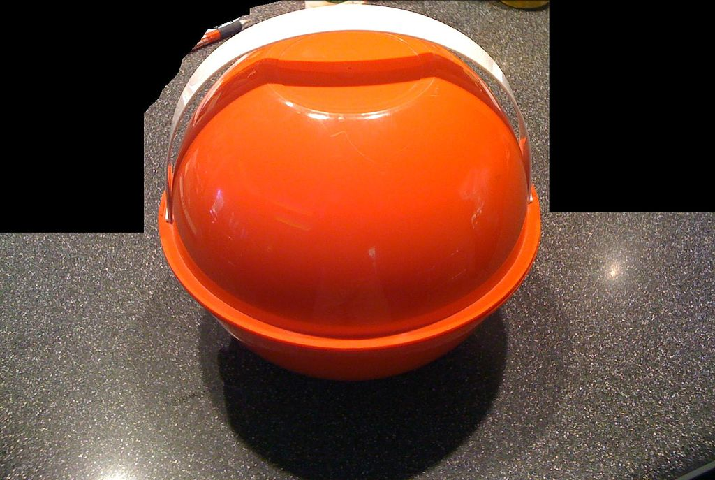 Orange Plastic Carrier with Multi Colored Dinnerware