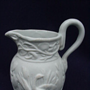 Small Porcelain Pitcher with Unglazed Exterior, Glazed Interior