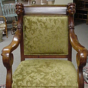Edwardian Upholstered Arm Chair with Carved Heads on Chair Rail and Paw Feet