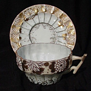 Japanese Cup and Saucer, Raised Slip Decoration