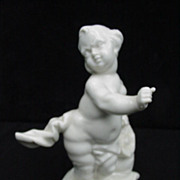 19th C. Nymphenburg Bustelli  White Porcelain Putti Carrying a Sack