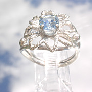 Sterling Exotic Blue Topaz Floral Ring