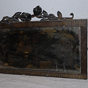 A French Art Deco Wrought Iron Wall Mirror with Floral Decor