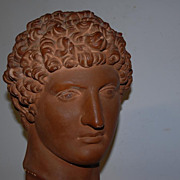 An Old Art Roman Head on a Wooden Base, David from Michelangelo