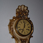 A Carved Gilt Wooden Cartel Wall Clock