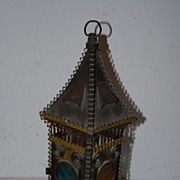 An Antique Wrought Iron Candle Lantern
