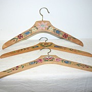 A Vintage Set of 3 Wooden Floral Painted Clothes Hangers