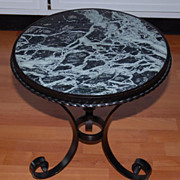 A Beautiful Scrolled Wrought Iron Table with Green Marble Top
