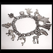 Vintage Sterling Silver Elco Charm Bracelet with 12 Charms Animals Hearts & Angels