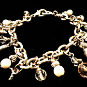 REDUCED VINTAGE Charm bracelet with 18 faux pearls, glass beads and small silver tone ones.