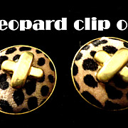 "SALE VINTAGE Faux Leopard Clip on dome Earrings with gold tone ""X""s"