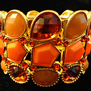 SALE VINTAGE Faceted Amber Crystal and orange lucite bead  stretch bracelet in gold tone