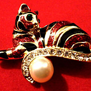 SALE VINTAGE tiger pin brooch balancing on a large faux pearl in gold tone with black and burg