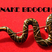 SALE VINTAGE BRASS serpent pin brooch with glazed enamel