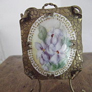 Brass Frame With Flowers On Porcelain