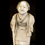 Antique Japanese Meiji Era Carved Ivory Netsuke Smiling Woman Peasant With Bamboo Stick